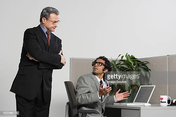 Boss watching over businessman