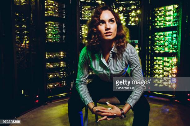 bossy businesswoman in server room - server room stock pictures, royalty-free photos & images