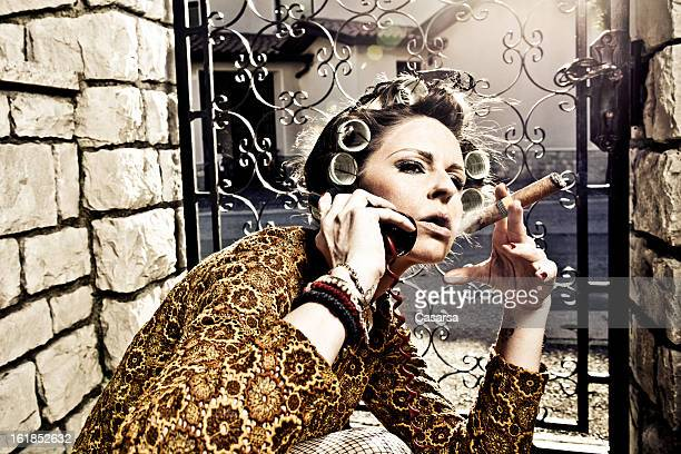 bossy housewife - beautiful women smoking cigars stock photos and pictures