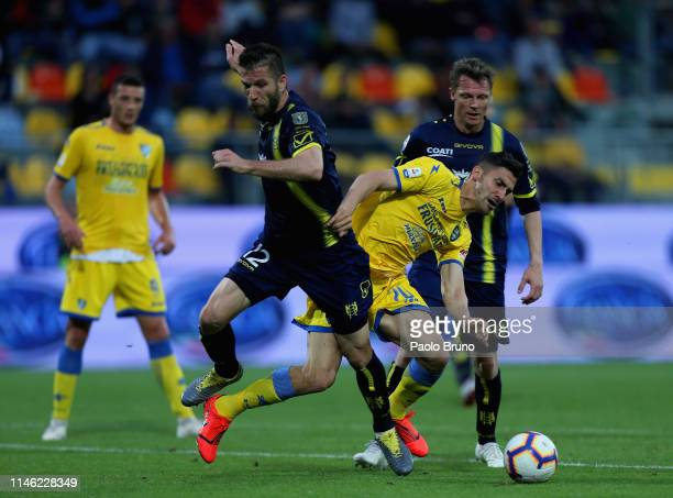 Bostjan Cesar of Chievo Verona competes for the ball with Marcello Trotta of Frosinone Calcio during the Serie A match between Frosinone Calcio and...