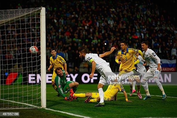 Bostjan Cesar of Slovenia scores the opening goal during the UEFA EURO 2016 qualifier playoff second leg match between Slovenia and Ukraine at...