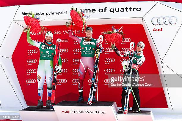 Bostjan Kline of Slovenia takes 2nd place Aleksander Aamodt Kilde of Norway takes 1st place and Marcel Hirscher of Austria takes 3rd place during the...
