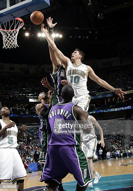 Bostjan Nachbar of the New Orleans Hornets shoots against Dan Gadzuric and Anthony Goldwire of the Milwaukee Bucks on March 12 2005 at the New...