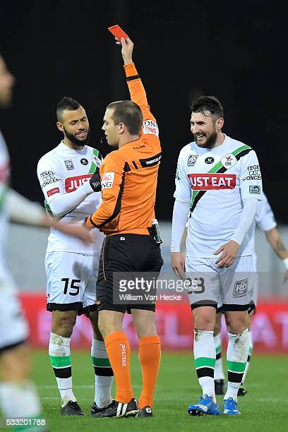 Bostock John midfielder of OHL is shown a red card by referee Vanbecelaere Denis Kostovski Jovan forward of OHL is laughing during the Jupiler Pro...