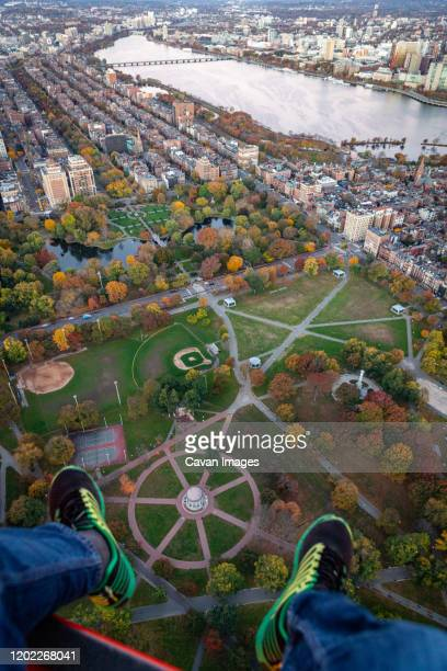 boston aerial shot of fall foliage park from helicopter vantage point. - boston common stock pictures, royalty-free photos & images