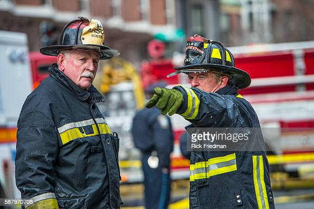 Boston arson investigators at the scene of fatal fire on Beacon St. In the Back Bay section of Boston, MA on March 26, 2014. 2 firefighters were...