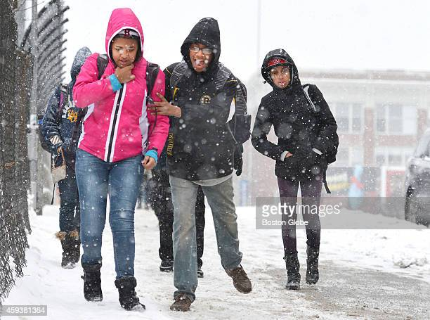 Boston Arts Academy students Yorgelis Sanchez Ricky Aguero and Lisbeth Hernandez make their way over a bridge over Brookline Avenue during a...