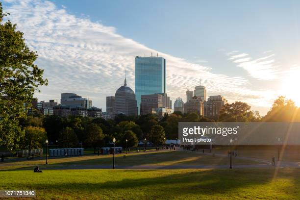 boston back bay skyline at sunset from the boston common hill in massachusetts, usa. - boston common stock pictures, royalty-free photos & images