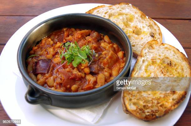 Boston baked beans with smoked ham hock, chorizo and chilli served with toasted sourdough bread