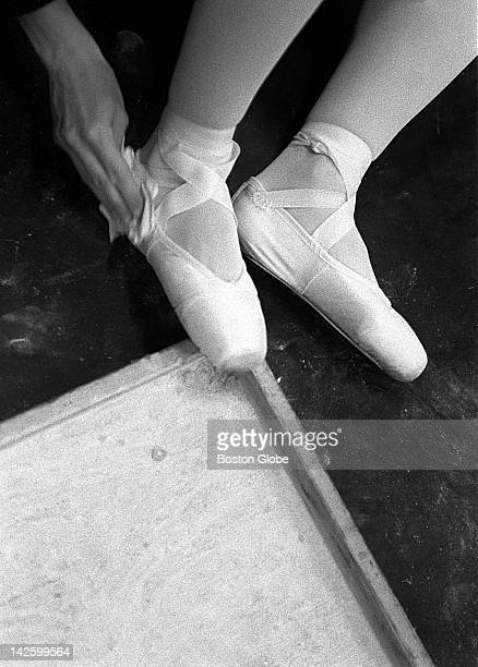 Boston Ballet dancer Tara Hench put on rosin from the rosin box before the dress rehearsal of 'From Distant Shores' at the Wang Center The rosin...