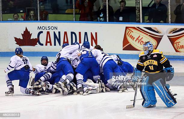 TORONTO ON MARCH 22 Boston Blades goalie Brittany Ott skates past a celebrating Toronto Furies team after winning the Championship game in the...