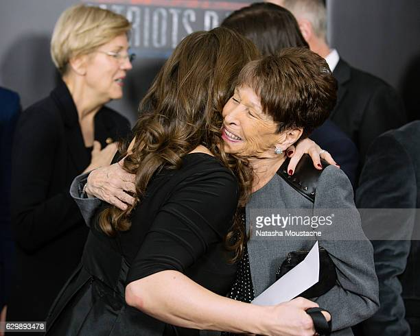 Boston Bombing survivor Jessica Downes hugs Alma Wahlberg at the 'Patriots Day' screening at the Boch Center Wang Theatre on December 14 2016 in...