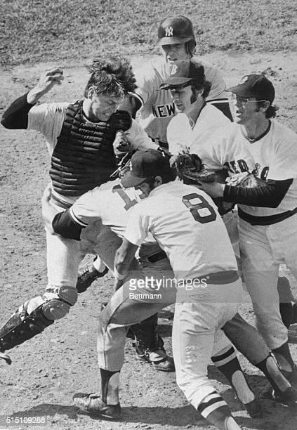 Boston: Bosox catcher Carlton Fisk , and Yankees' Thurman Munson held by Bosox Carl Yastrzemski , battle during 9th inning melee, Fenway Park . Both...