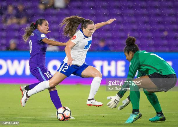 Boston Breakers defender Allysha Chapman defends Orlando Pride forward Marta Vieira de Silva as Boston Breakers goalkeeper Abby Smith makes the save...