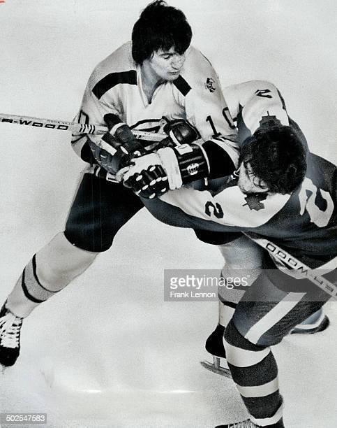 Boston bruin head-hunters at work. Carol Vadnais clobbers Leafs' Ian Turnbull