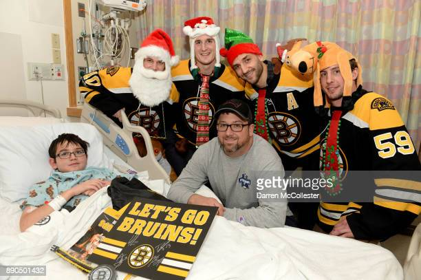 Boston Bruins Ander Bjork Noel Acciari Patrice Bergeron and Tim Schaller visit with Luke and Dad at Boston Children's Hospital December 11 2017 in...