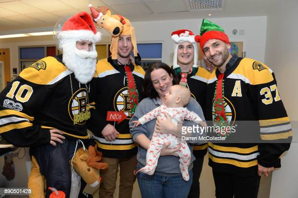 Boston Bruins Anders Bjork Tim Schaller Noel Acciari and Patrice Bergeron visit with Gabriella and Mom at Boston Children's Hospital December 11 2017...