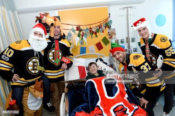 Boston Bruins Anders Bjork Tim Schaller Patrice Bergeron and Noel Acciari visit with Graham at Boston Children's Hospital December 11 2017 in Boston...