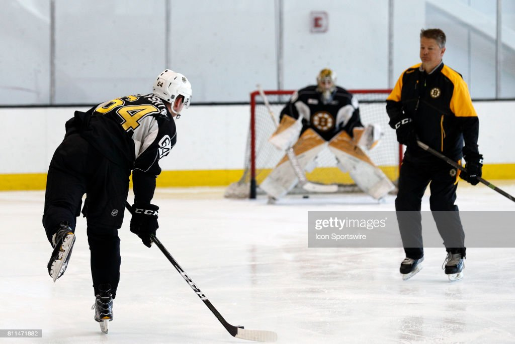 Boston Bruins assistant coach watches Boston Bruins forward Zach Senyshyn (64) shoot during Bruins Development Camp on July 8, 2017 at Warrior Ice Arena in Boston, Massachusetts.