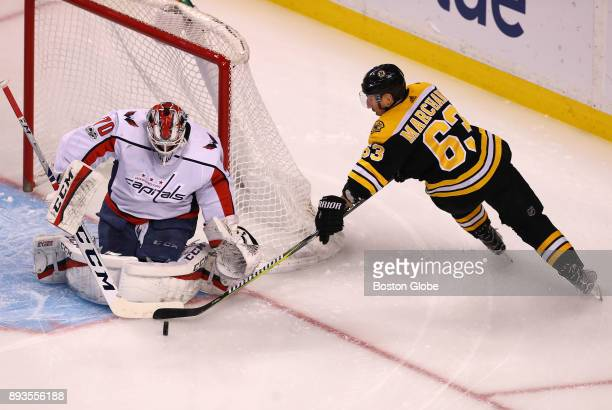 Boston Bruins' Brad Marchand loses control of the puck in the first period and can't get the shot away as Capitals goalie Branden Holtby makes the...