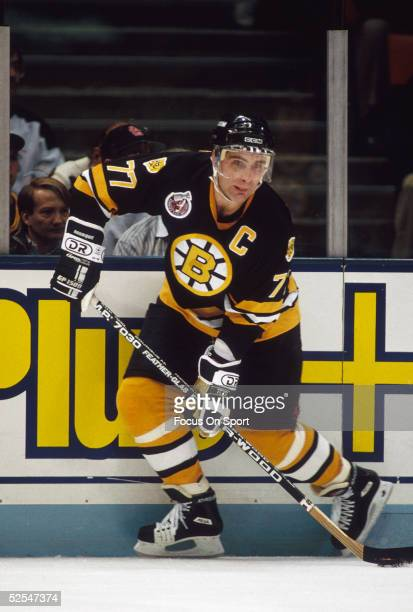 Boston Bruins' captain Ray Bourque skates with the puck and looks to pass during a game at the Meadowlands Arena in Boston Massachusetts