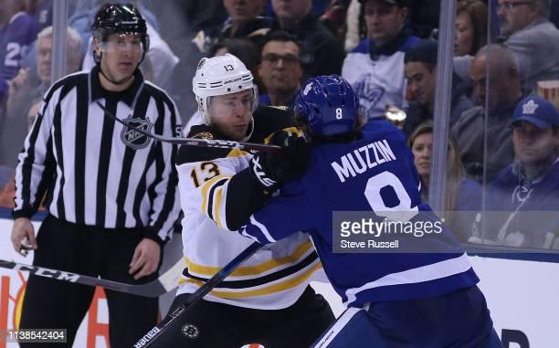 TORONTO ON APRIL 21 Boston Bruins center Charlie Coyle checks Toronto Maple Leafs defenseman Jake Muzzin as the Toronto Maple Leafs play the Boston...