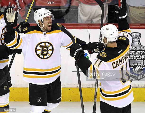Boston Bruins center Chris Kelly and Boston Bruins center Gregory Campbell celebrate the overtime win over the Washington Capitals The Boston Bruins...