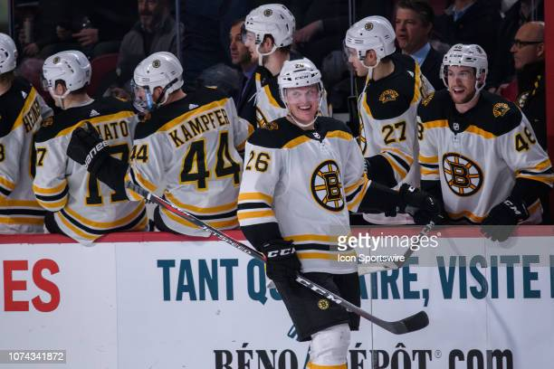 Boston Bruins center Colby Cave celebrates with teammates during the second period of the NHL game between the Boston Bruins and the Montreal...