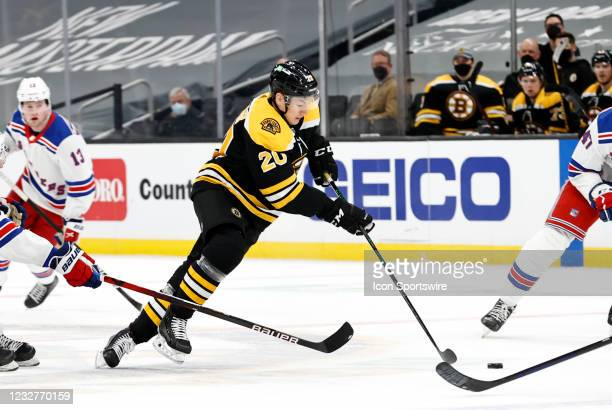 Boston Bruins center Curtis Lazar picks the puck up in the neutral zone during a game between the Boston Bruins and the New York Rangers on May 8 at...