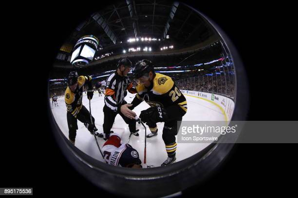 Boston Bruins center David Backes and Boston Bruins center Riley Nash sandwich referee Chris Lee on top of Columbus Blue Jackets defenseman Markus...