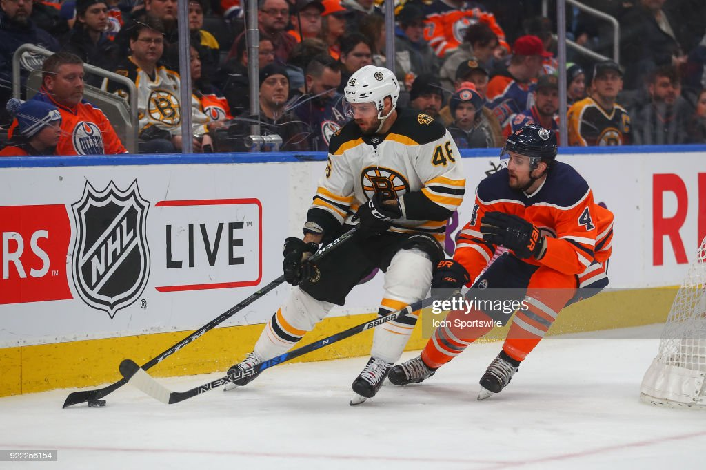 Boston Bruins Center David Krejci (46) protects the puck from Edmonton Oilers Defenceman Kris Russell (4) during the Edmonton Oilers versus the Calgary Flames at Rogers Place on February 20, 2018 in Edmonton, Alberta.