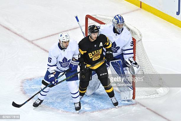 Boston Bruins Center David Krejci tries to get position on Toronto Maple Leafs Defenceman Roman Polak in front of the net During the Boston Bruins...