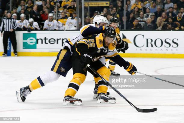 Boston Bruins center Dominic Moore pressured by Nashville Predators center Ryan Johansen during a regular season NHL game between the Boston Bruins...