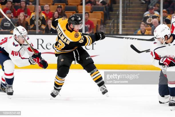 Boston Bruins center Karson Kuhlman gets a shot away during a preseason game on September 16 between the Boston Bruins and the Washington Capitals at...