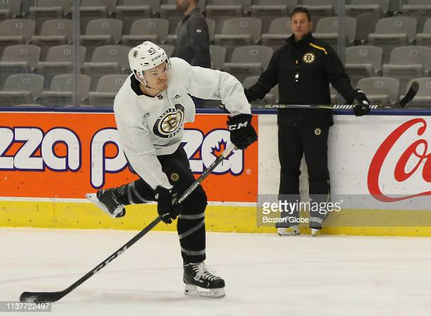 Boston Bruins center Karson Kuhlman takes a shot on goal in front of head coach Bruce Cassidy during a practice the day before Game 4 of the Eastern...