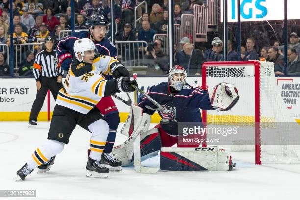 Boston Bruins center Noel Acciari attempts to deflect the puck into the goal as Columbus Blue Jackets goaltender Sergei Bobrovsky defends in a game...