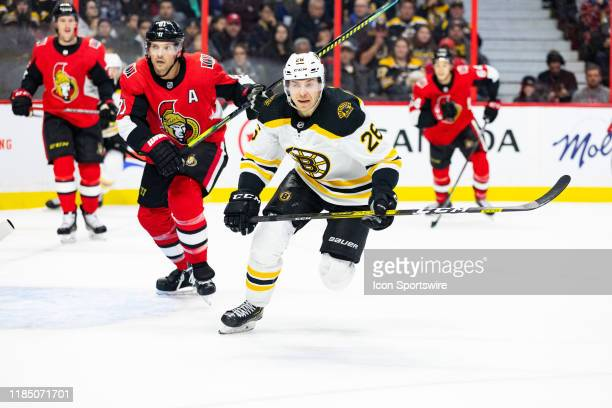 Boston Bruins Center Par Lindholm closes on the play during first period National Hockey League action between the Boston Bruins and Ottawa Senators...