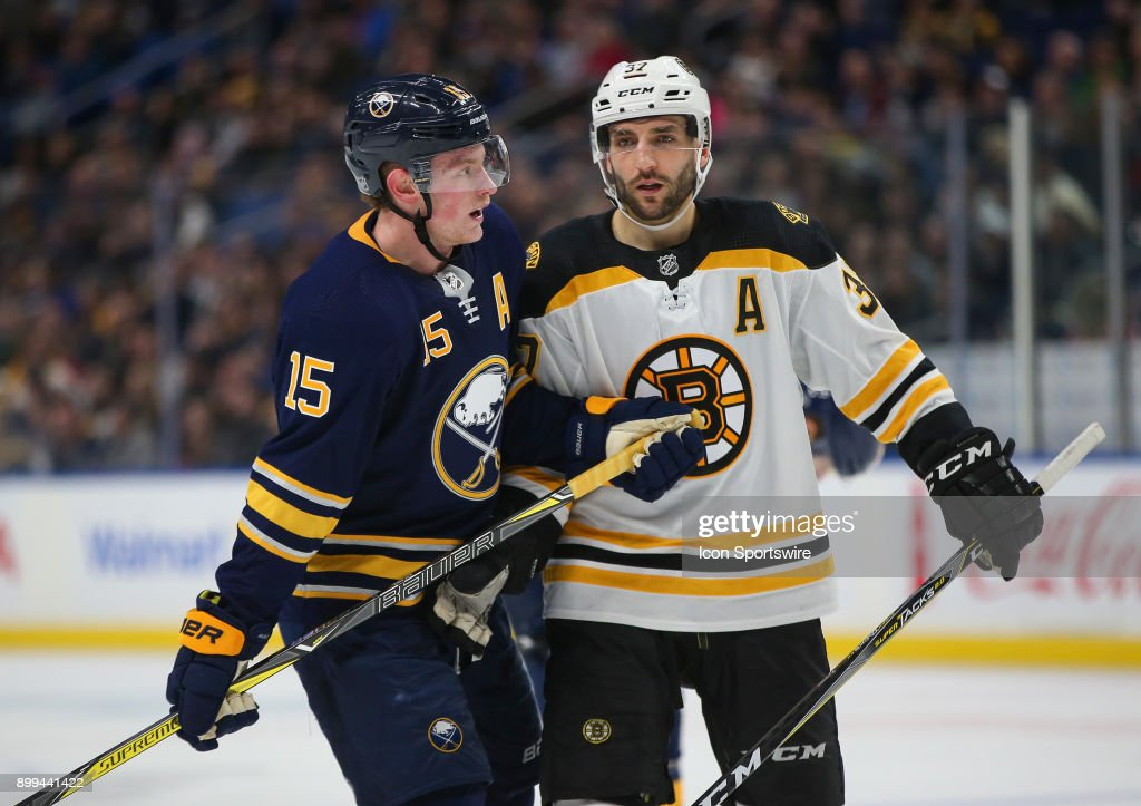 Boston Bruins center Patrice Bergeron and Buffalo Sabres center Jack