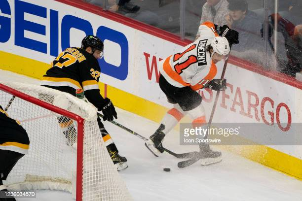 Boston Bruins Center Patrice Bergeron and Philadelphia Flyers Right Wing Travis Konecny battle for the puck during the second period of a National...