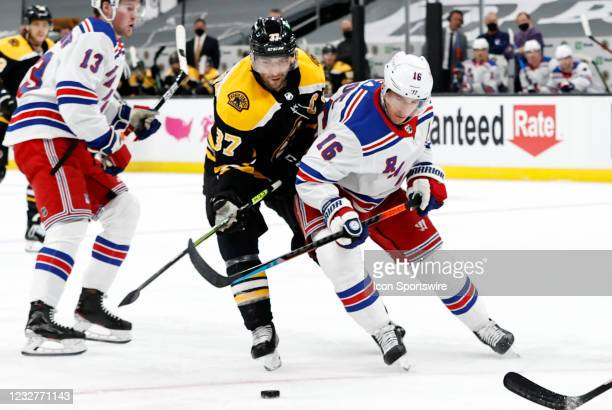 Boston Bruins center Patrice Bergeron pressures New York Rangers center Ryan Strome during a game between the Boston Bruins and the New York Rangers...