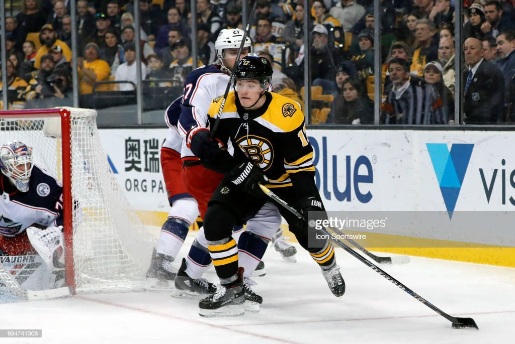 Boston Bruins center Ryan Donato (17) looks back to the point with Columbus Blue Jackets defenseman Ryan Murray (27) on his back during a game between the Boston Bruins and the Columbus Blue Jackets on March 19, 2018, at TD Garden in Boston, Massachusetts. The Blue Jackets defeated the Bruins 5-4 (OT).