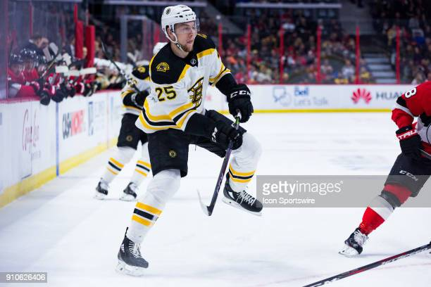 Boston Bruins Defenceman Brandon Carlo follows through on a shot during first period National Hockey League action between the Boston Bruins and...