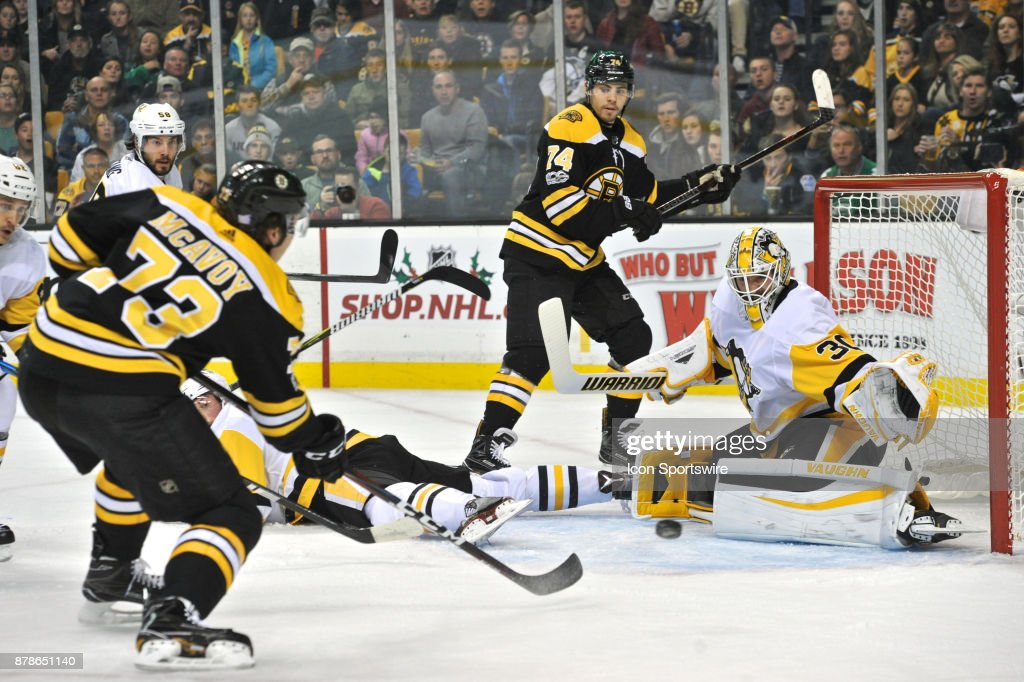 Boston Bruins Defenceman Charlie McAvoy (73) takes the shot on Pittsburgh Penguins Goalie Matt Murray (30). During the Boston Bruins game against the Pittsburgh Penguins on November 24, 2017 at TD Bank Garden in Boston, MA.