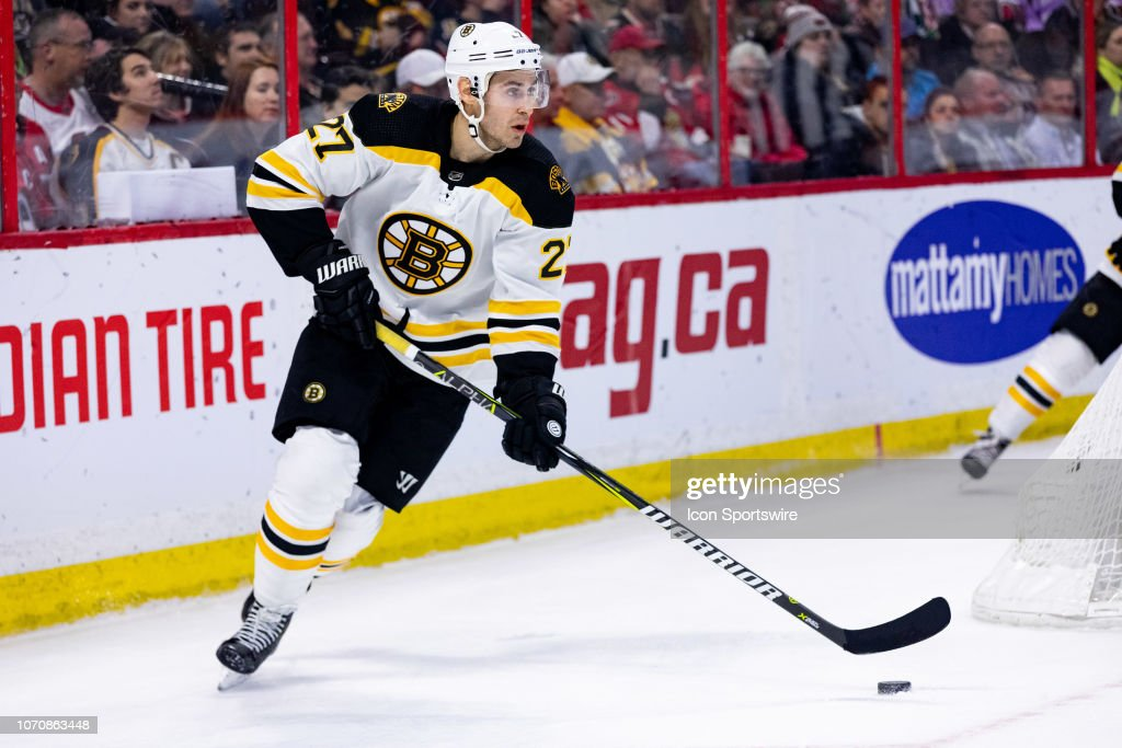 the best attitude 9720c 12b90 Boston Bruins Defenceman John Moore skates with the puck ...