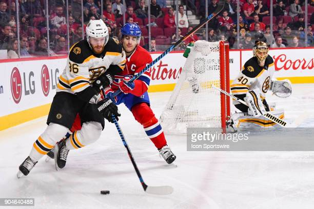 Boston Bruins Defenceman Kevan Miller and Montreal Canadiens Left Wing Max Pacioretty battling for control of the puck during the Boston Bruins...