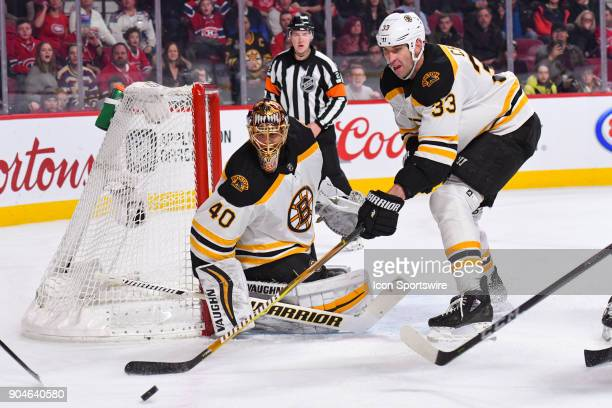 Boston Bruins Defenceman Zdeno Chara tries to push away the puck from Boston Bruins Goalie Tuukka Rask during the Boston Bruins versus the Montreal...