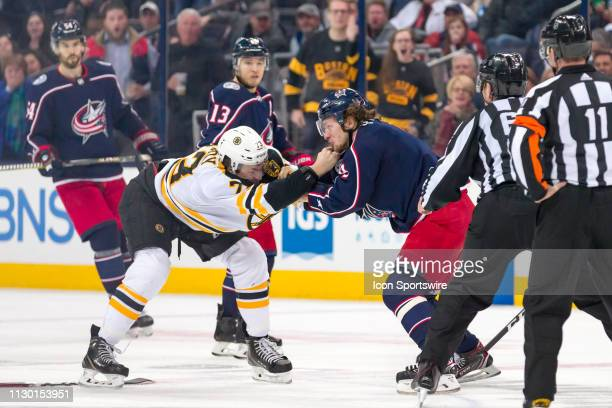 Boston Bruins defenseman Charlie McAvoy and Columbus Blue Jackets left wing Artemi Panarin fight in a game between the Columbus Blue Jackets and the...