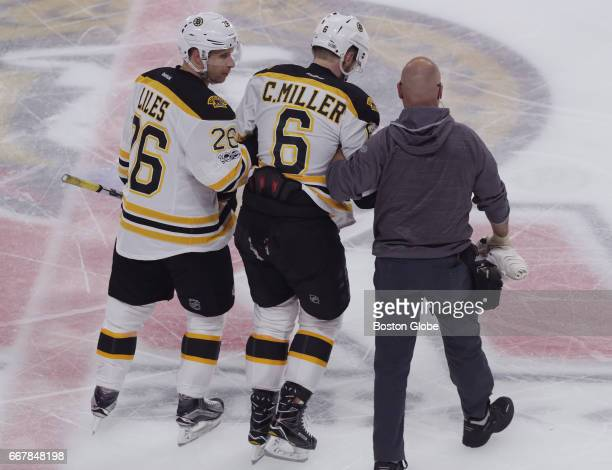 Boston Bruins defenseman Colin Miller is helped off the ice after suffering an injury during the second period The Boston Bruins visit the Ottawa...