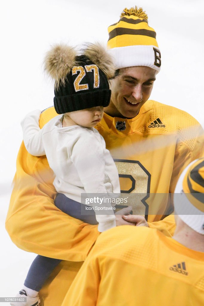 the latest c90e0 daf77 Boston Bruins defenseman John Moore and daughter look on ...