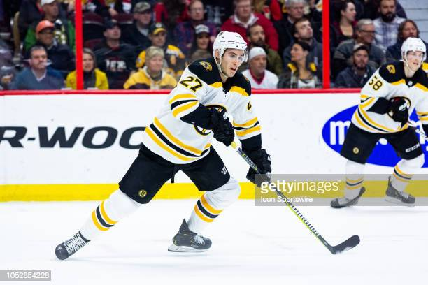 Boston Bruins defenseman John Moore tracks the play during first period National Hockey League action between the Boston Bruins and Ottawa Senators...